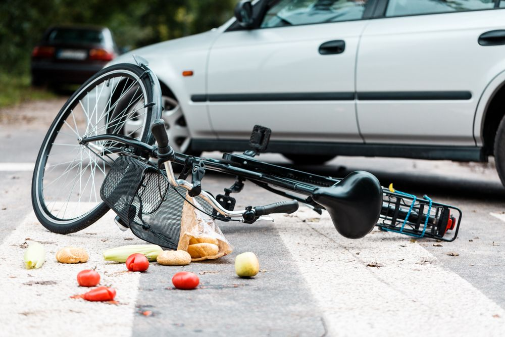 crashed bicycle accident near car