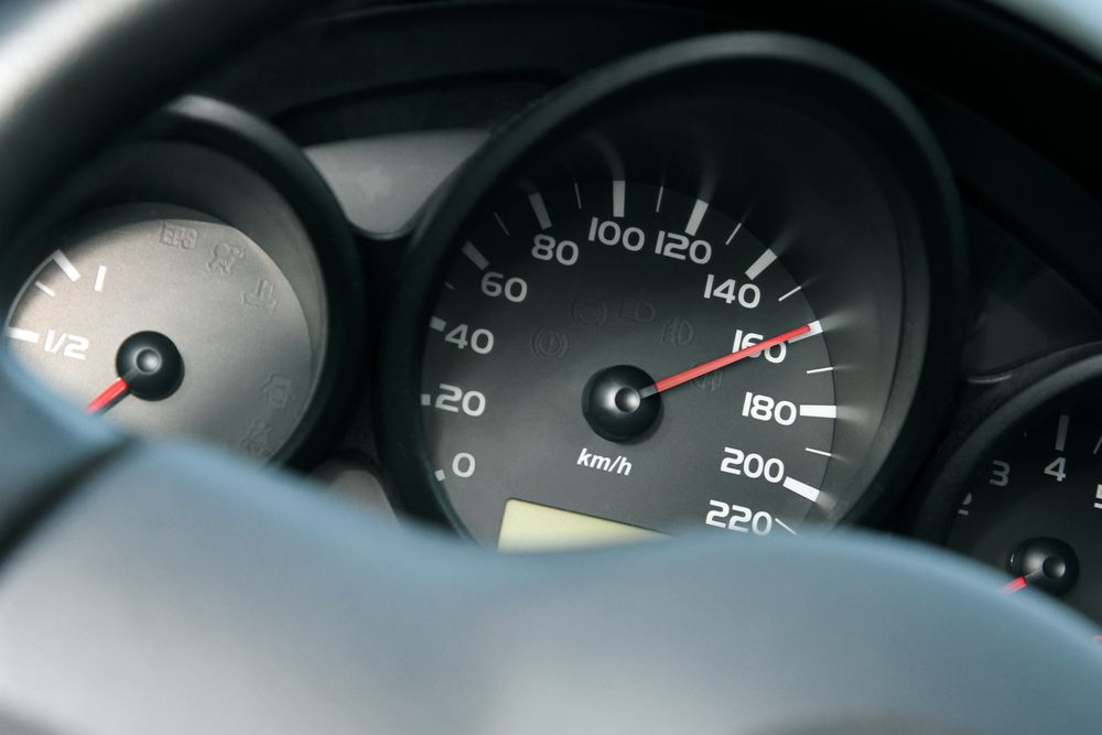car speedometer going 160 km/h