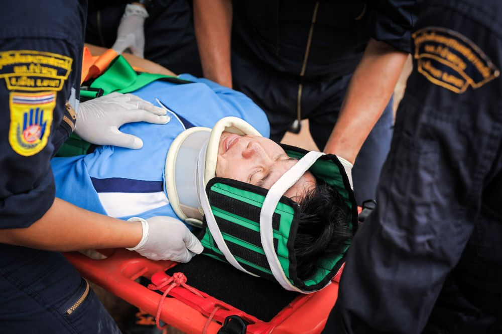 man on stretcher for spinal injury