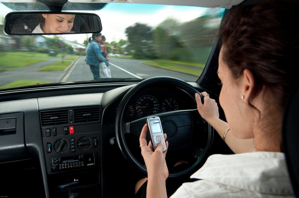 woman distracted driving on cellphone
