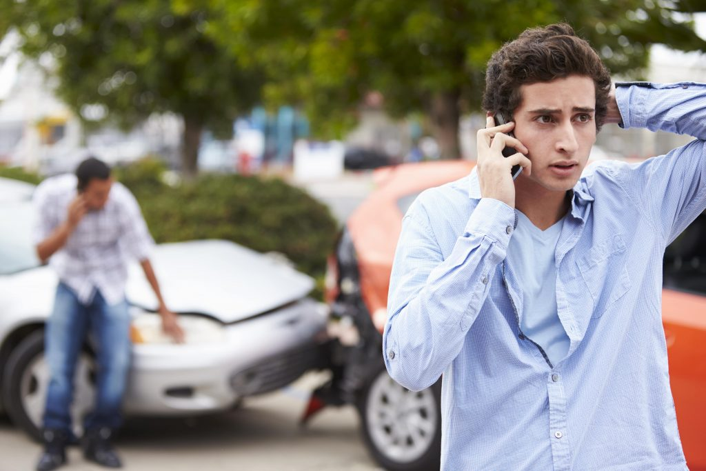 stressed person in car accident that is not their car