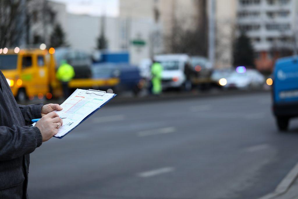 insurance adjuster calculating auto damage